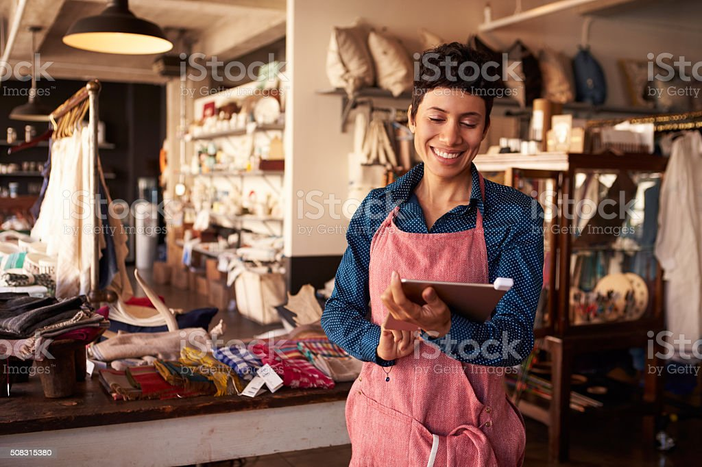 Female Owner Of Gift Store With Digital Tablet stock photo