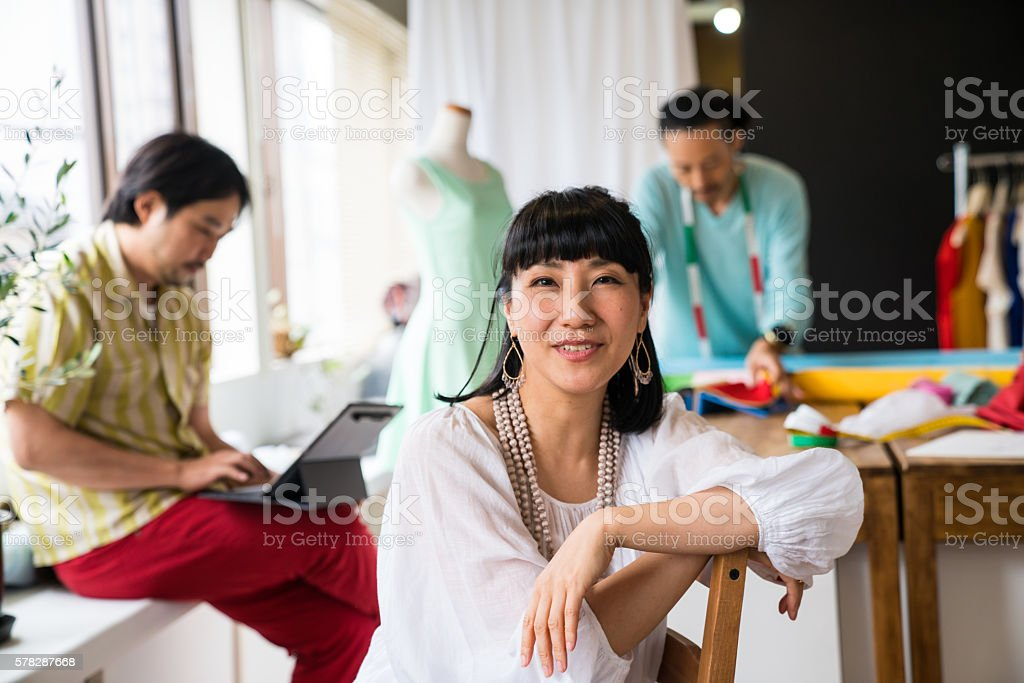 Female owner or executive at a fashion design firm stock photo