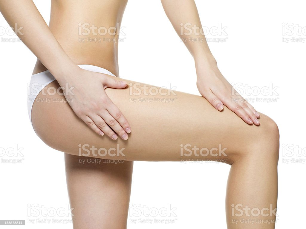 Female pampering skin on her legs royalty-free stock photo