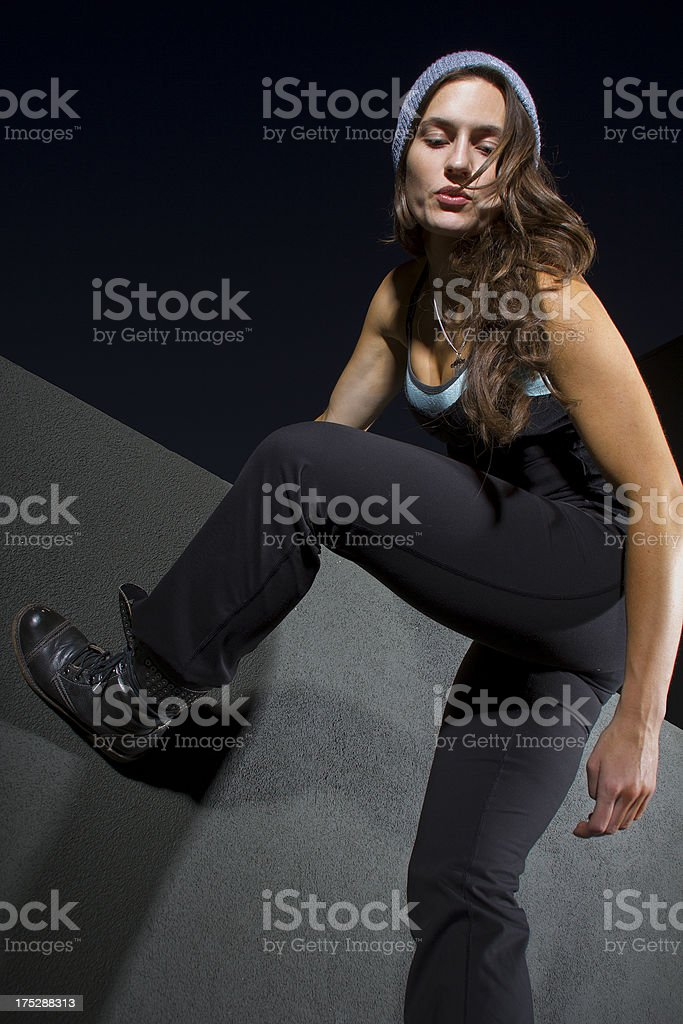 Female Parkour Freerunner Climbing a Rooftop at Night royalty-free stock photo