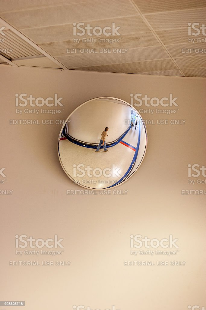 Female passenger reflection in convex mirror stock photo