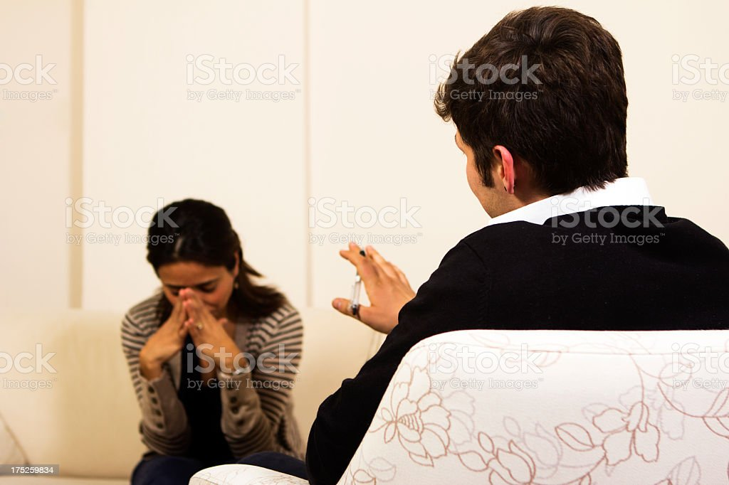 Female patient talking to a psychiatrist royalty-free stock photo