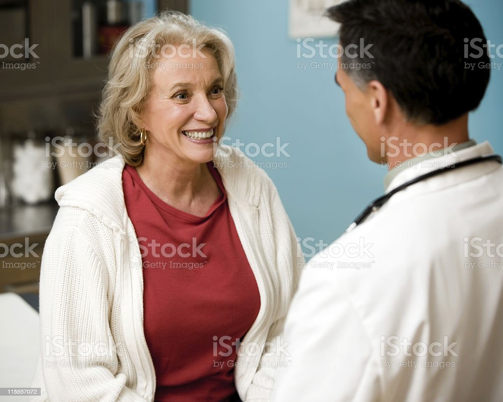 Female Patient talking to Doctor stock photo