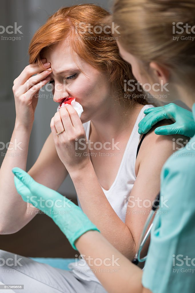 Female patient with bloody nose stock photo