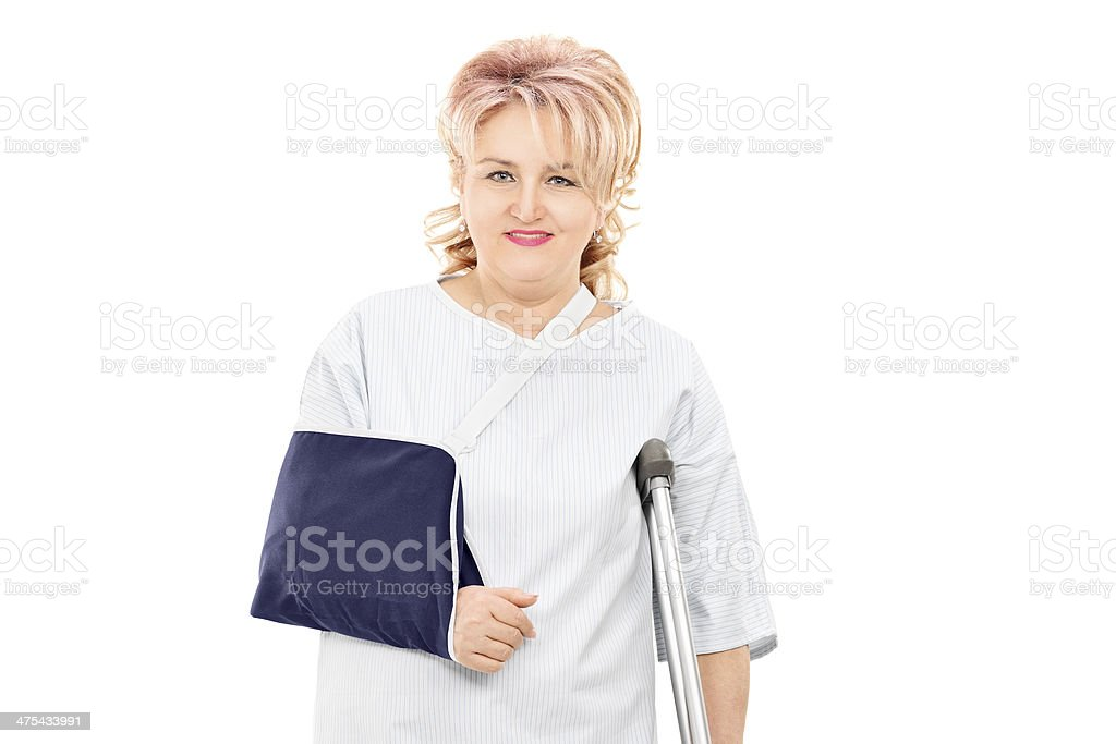 Female patient with broken arm standing royalty-free stock photo