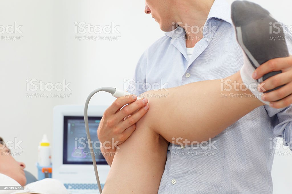 female patient's knee joint dynamic test stock photo