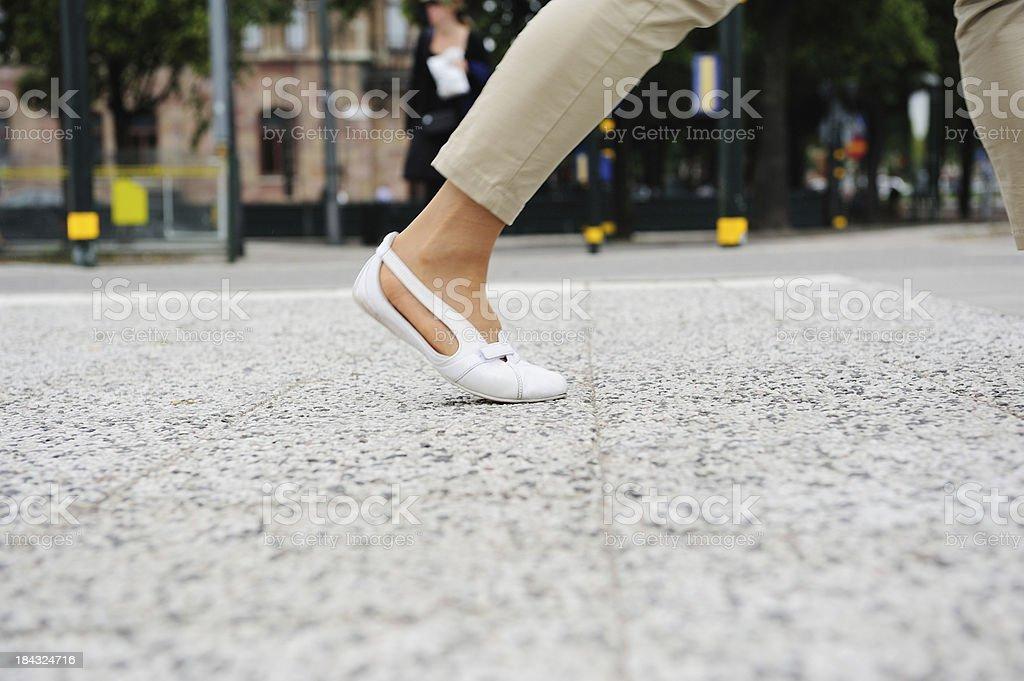 Female pedestrian on tiled street stock photo