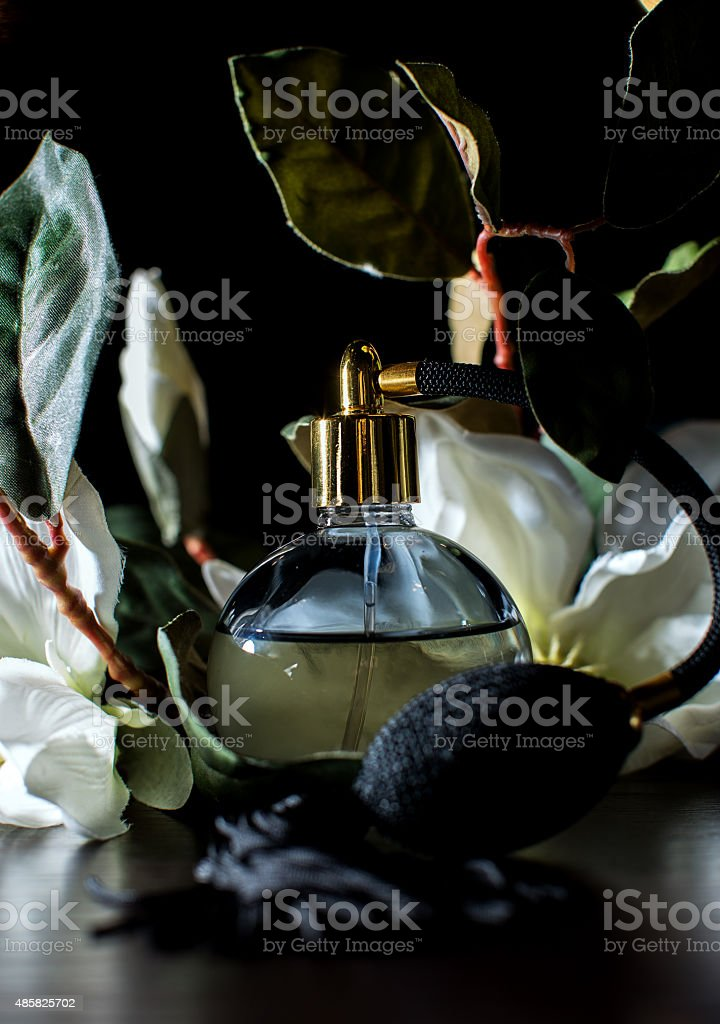 Female perfume with a flowers stock photo