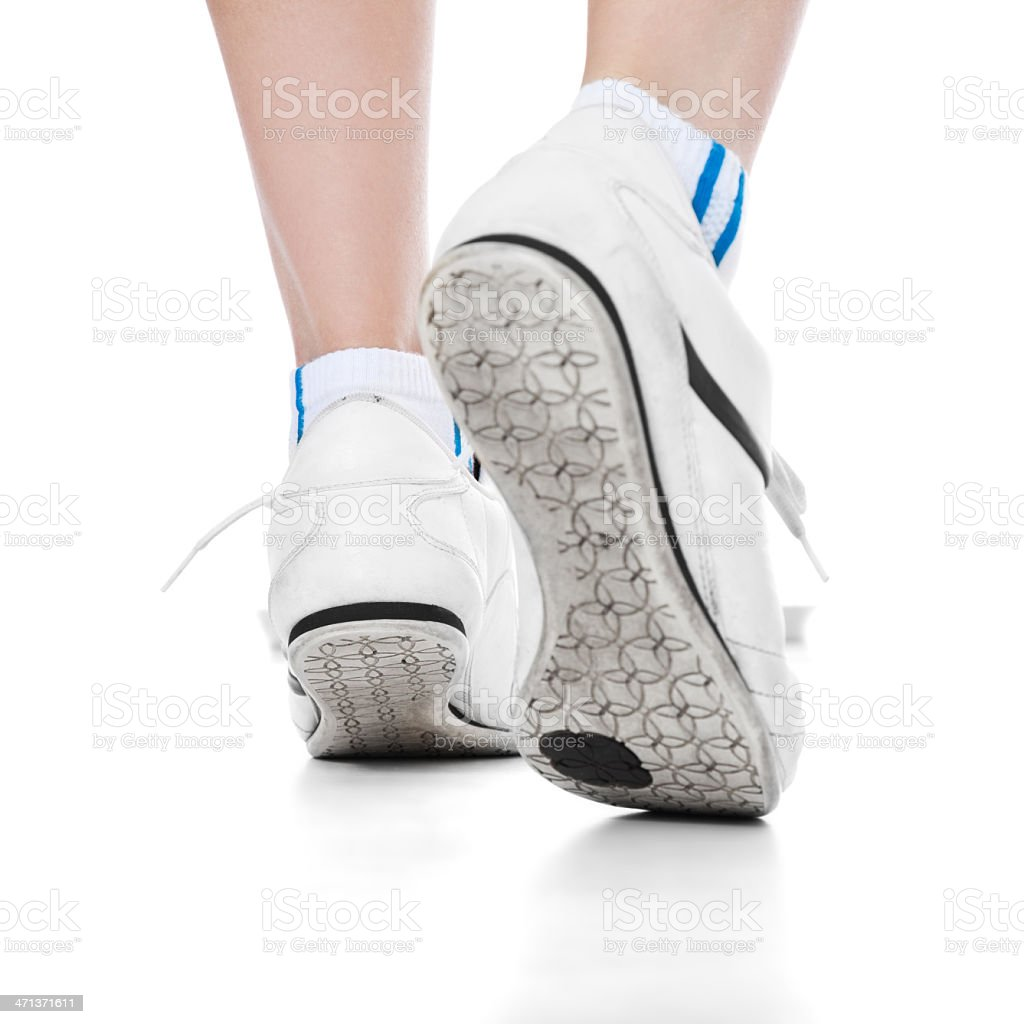 Female person walking in athletic shoes royalty-free stock photo