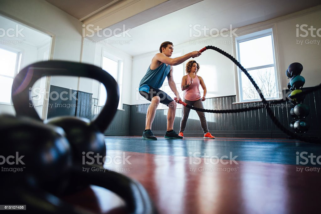 Female Personal Trainer and Her Client stock photo