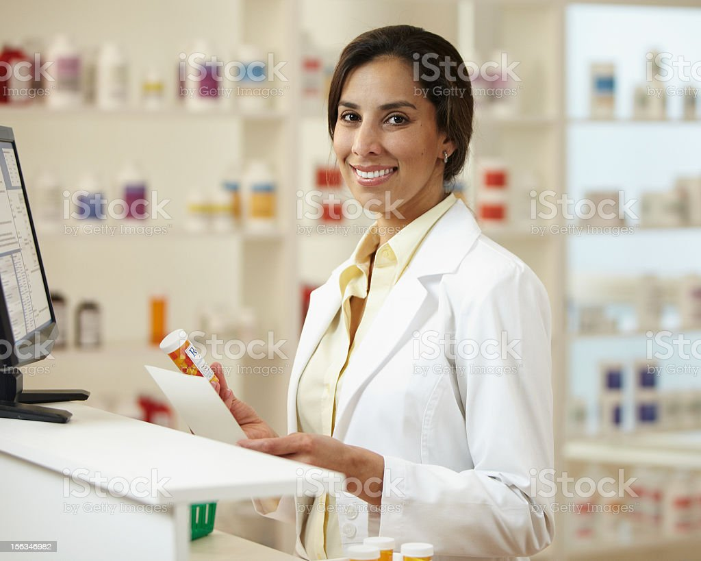 Female Pharmacist with RX and Pill Bottle stock photo