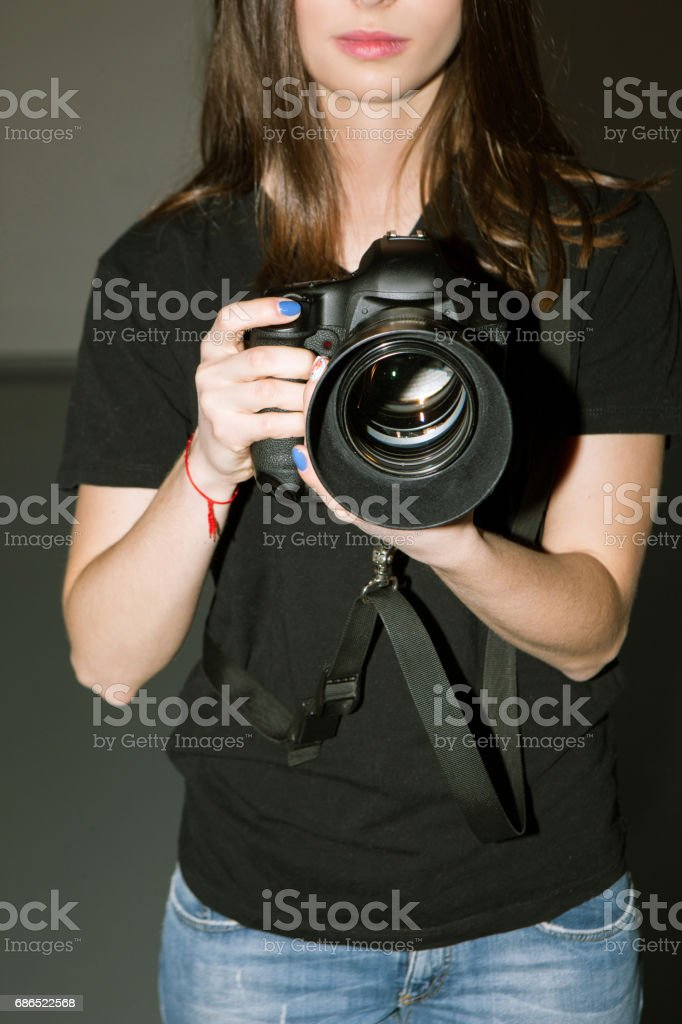 Female photographer and camera with big lens stock photo