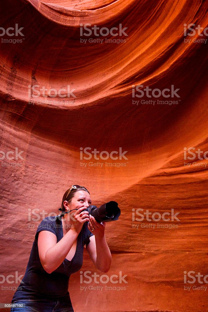 Female Photographer at Antelope Canyon in Arizona, USA stock photo