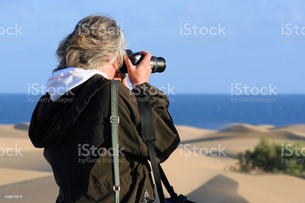 'Female photographer', Beach, Sand dunes royalty-free stock photo