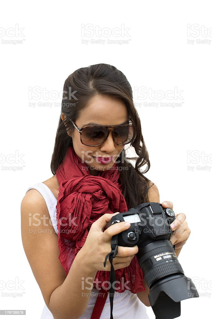 Female photographer holding a camera royalty-free stock photo