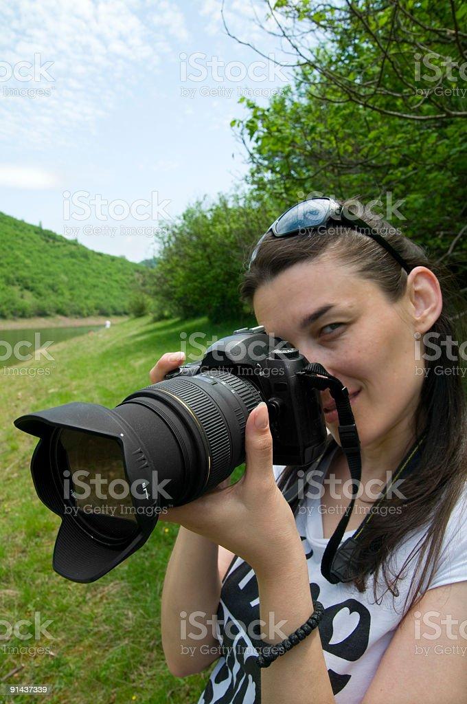Female photographer holding camera royalty-free stock photo