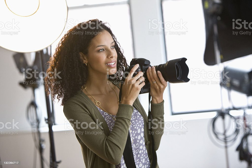Female photographer in studio stock photo