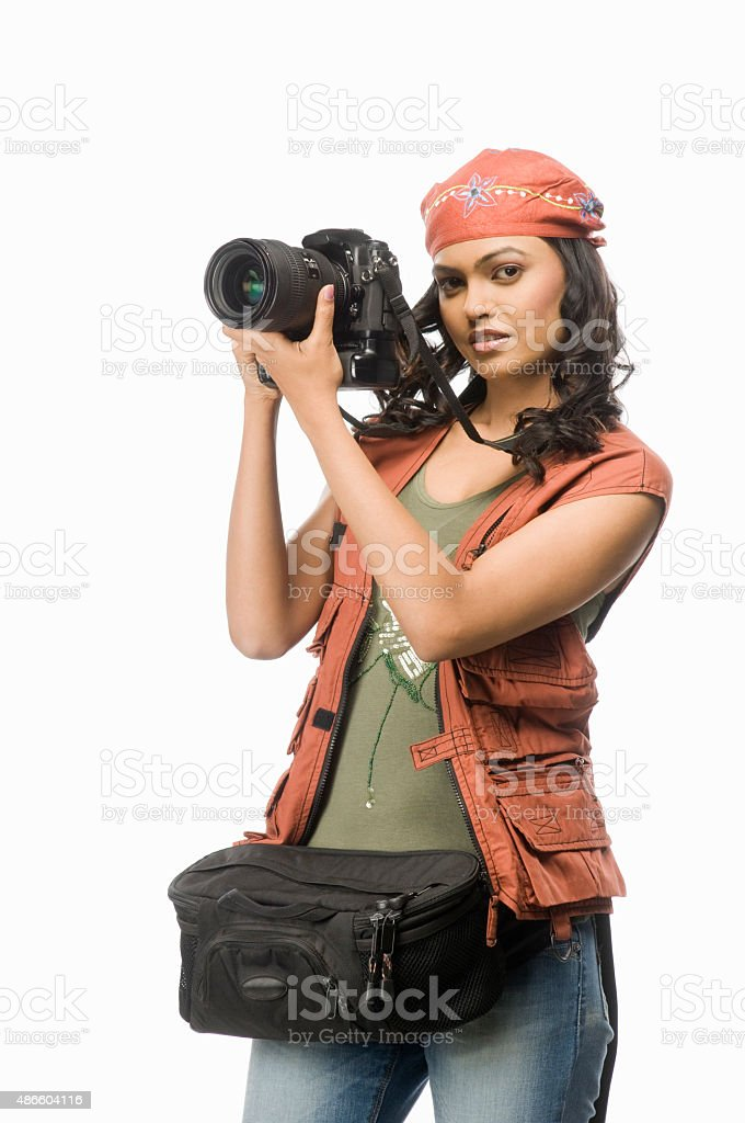 Female photographer photographing with digital camera stock photo