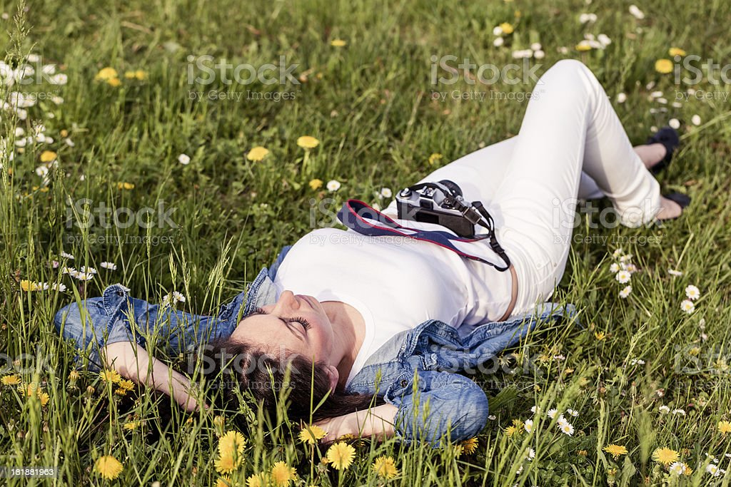 Female photographer relaxing in a park royalty-free stock photo