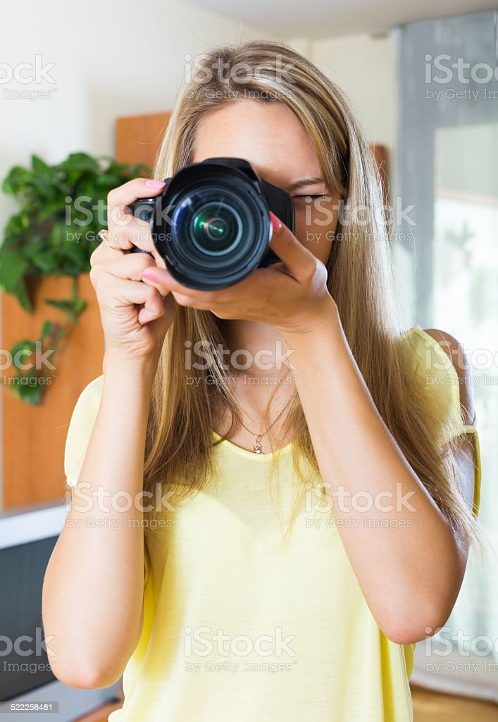 Female photographer testing new camera stock photo
