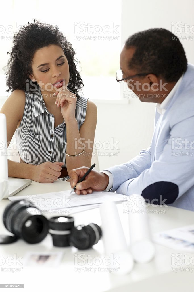Female photography student with her male mentor royalty-free stock photo