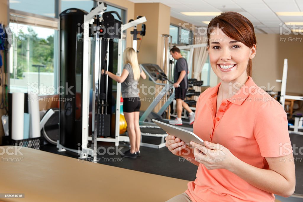 Female physical therapist charting on a digital tablet royalty-free stock photo