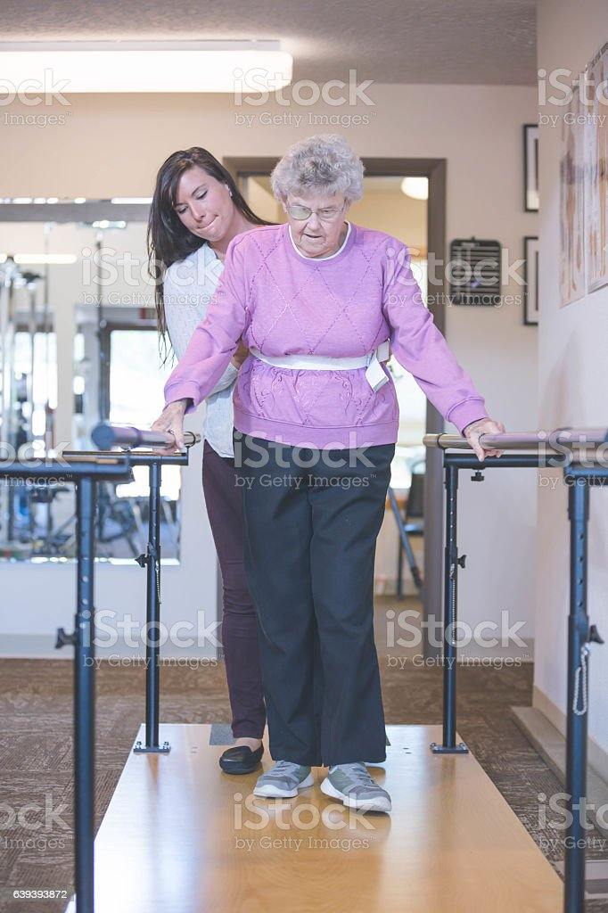 Female physical therapist working with a female senior stock photo