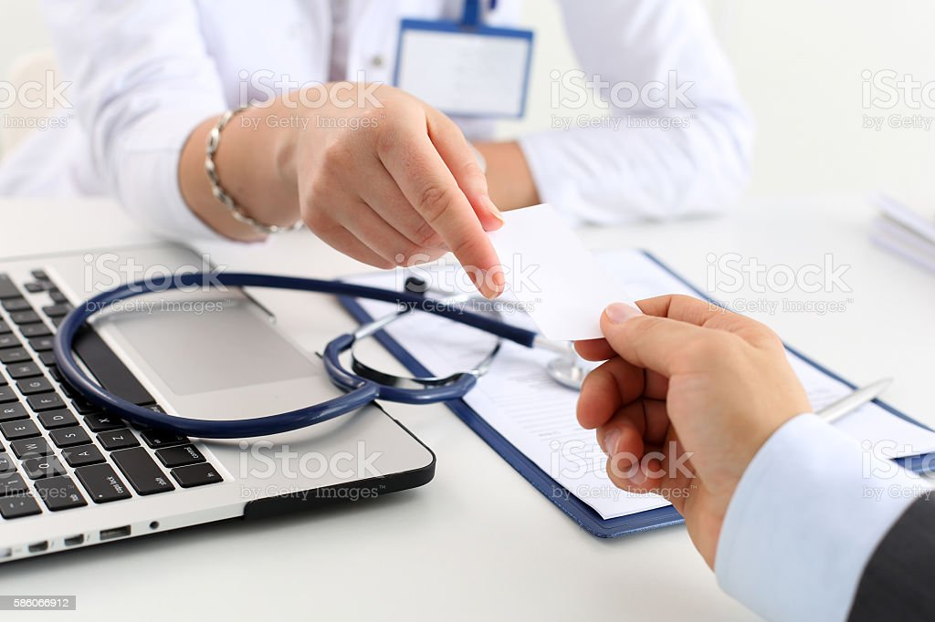 Female physician hand hold and give calling card stock photo