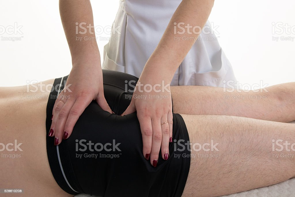 Female physiotherapist doing a buttock massage isolated stock photo