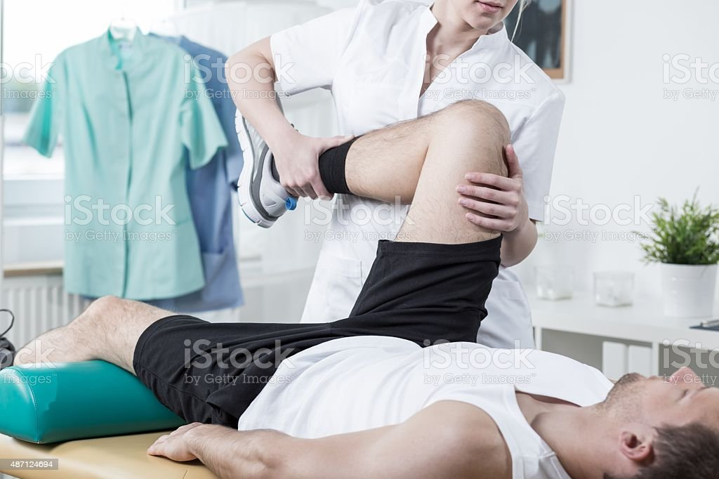 Female physiotherapist training with man stock photo