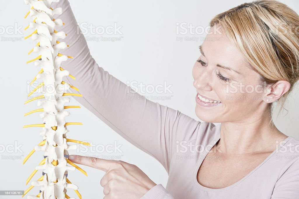 Female physiotherapist with spine stock photo