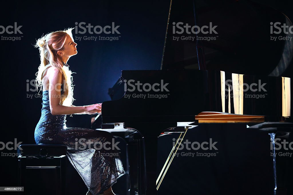 Female pianist in a concert. stock photo