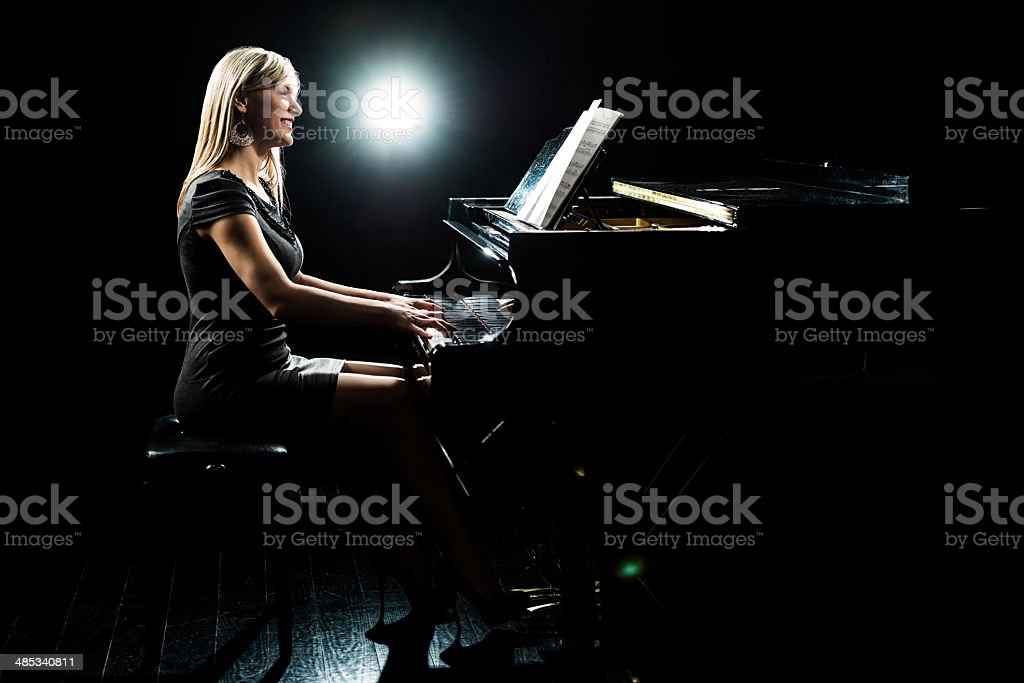 Female pianist. stock photo