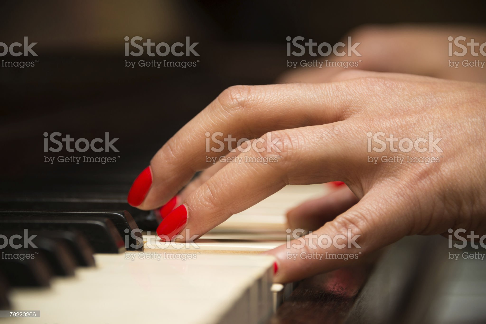 Female pianist playing the piano royalty-free stock photo