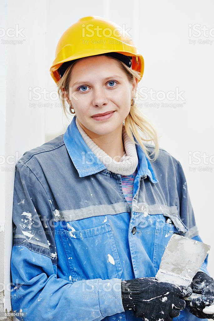 Female plasterer portrait stock photo