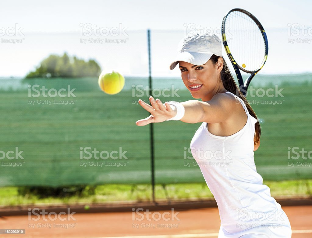 Female playing tennis stock photo