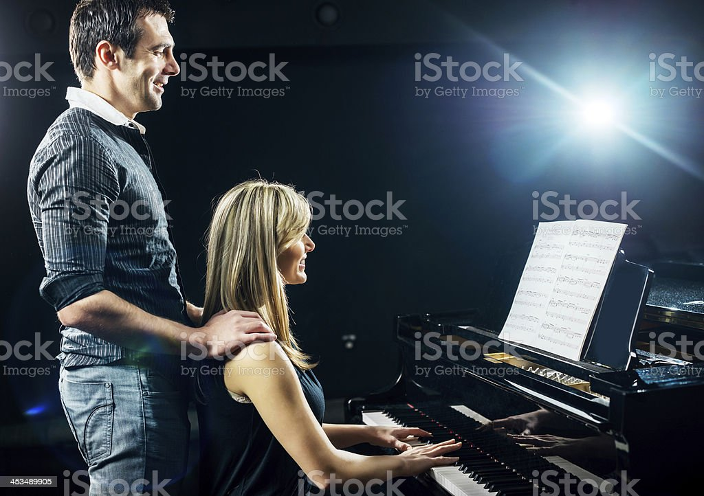 Female playing the piano. royalty-free stock photo