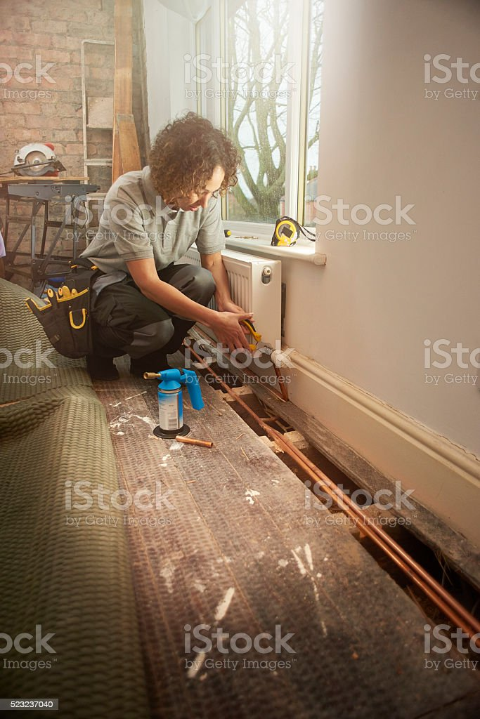 female plumber in home renovation stock photo