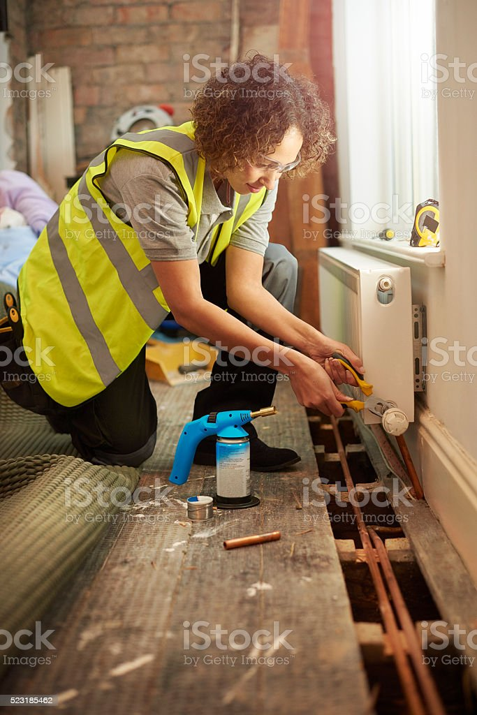 female plumber on site stock photo