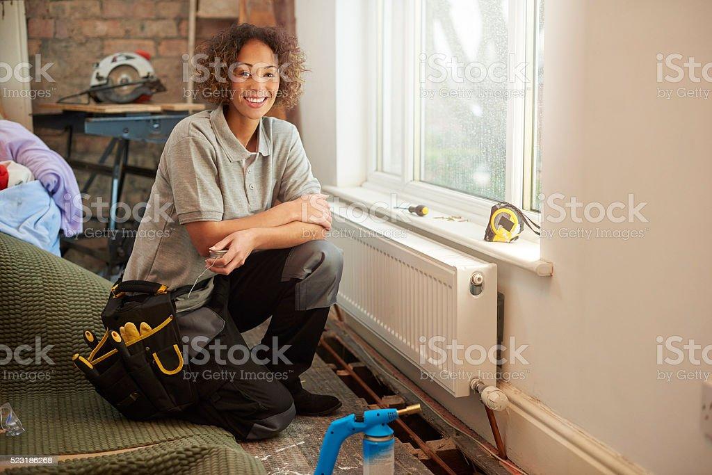 female plumber on site stock photo