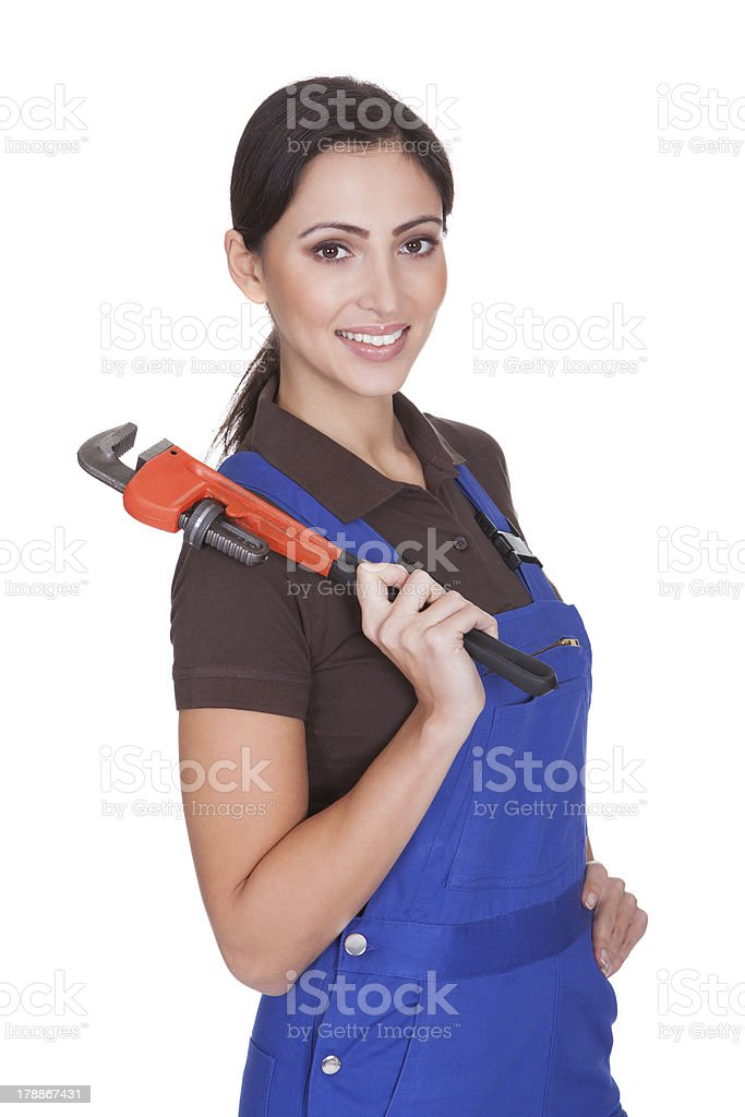Female Plumber With A Wrench royalty-free stock photo