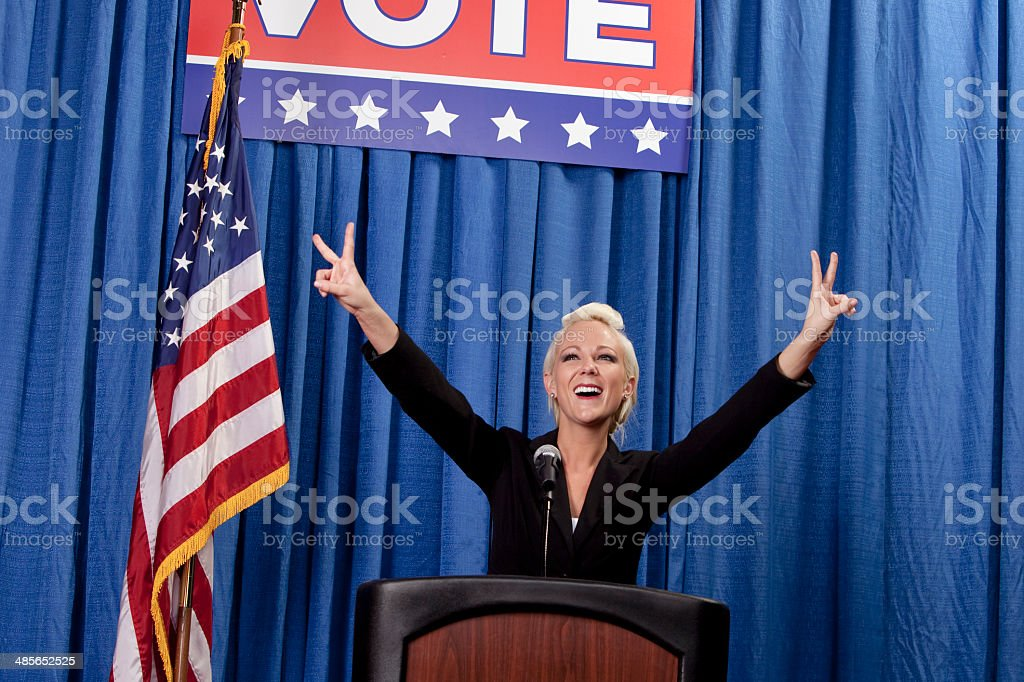 Female Politician waving peace sign stock photo
