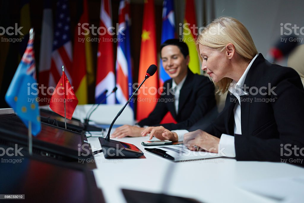 Female politicians at summit stock photo