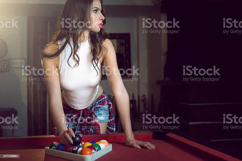 Female pool player setting balls stock photo