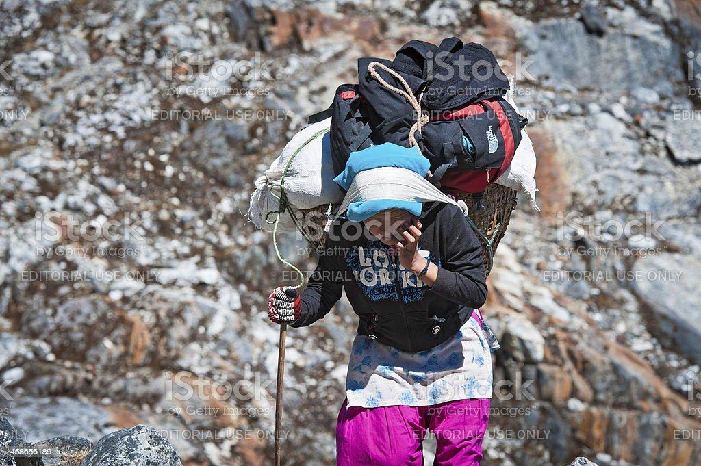 Female porter carrying heavy load Himalayas Nepal royalty-free stock photo