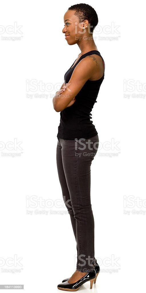 Female portrait of woman standing sideways in heels stock photo
