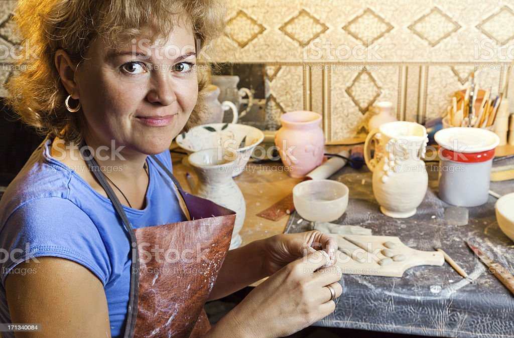 Female potter at work royalty-free stock photo