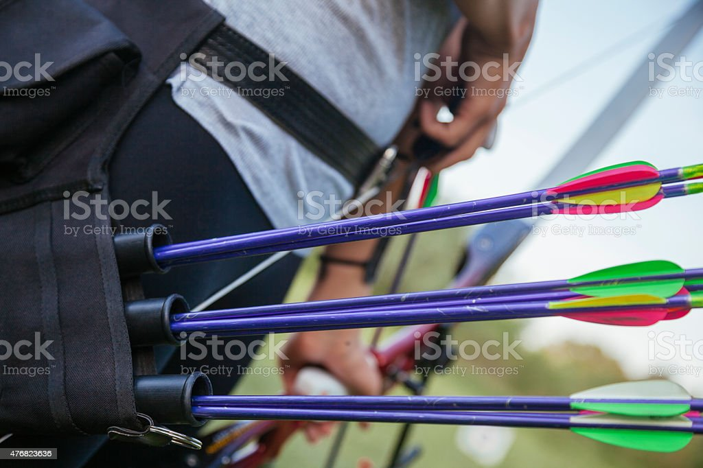 Female Practicing Archery At The Range stock photo