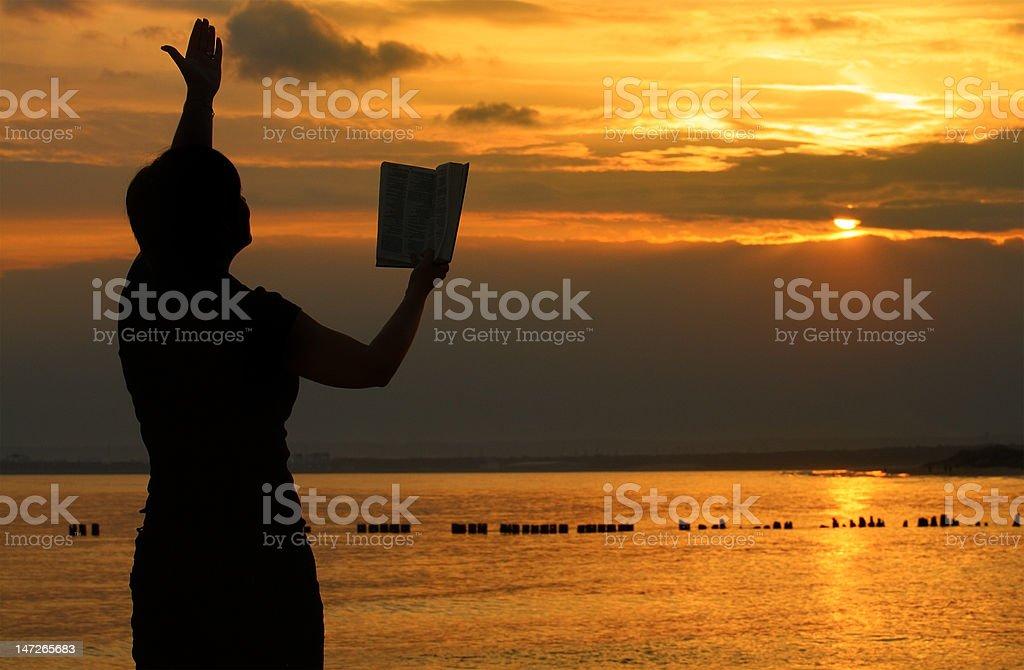 female praying with bible royalty-free stock photo
