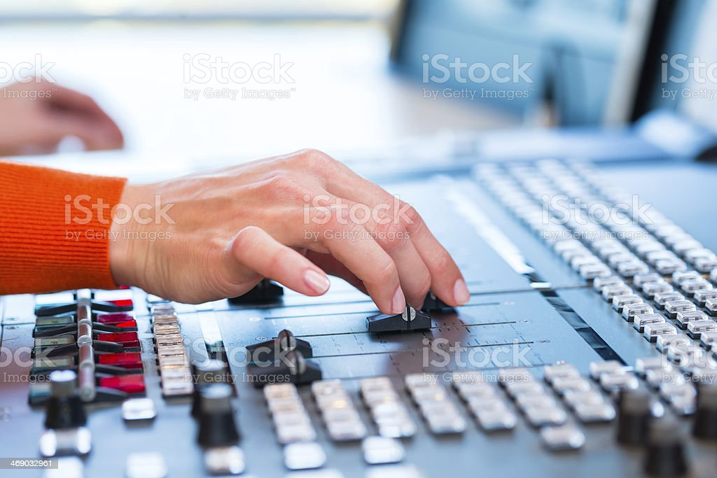 Female presenter in radio station on air stock photo